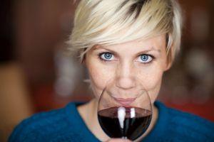 A beautiful woman enjoying red wine