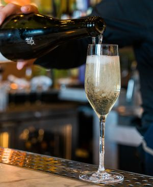 Champagne being poured into a glass with a lot of bubbles