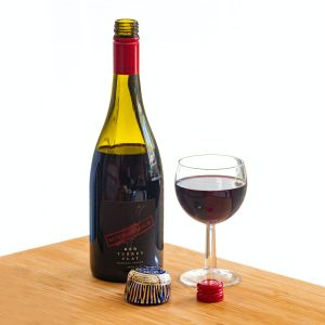Red screw top wine with glass