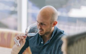 Dustin Wilson Tasting Wine
