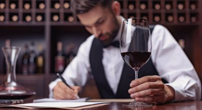 Man Studying a Glass of Wine