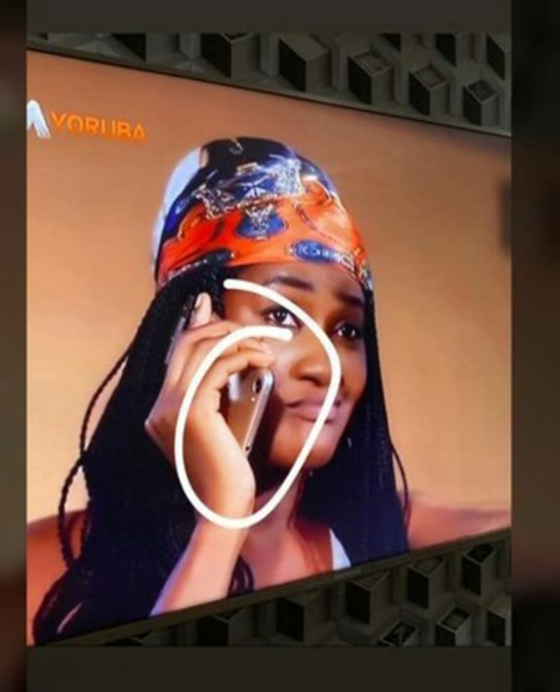 Girl Busted Making Call In A Strange Manner In A Nollywood Movie