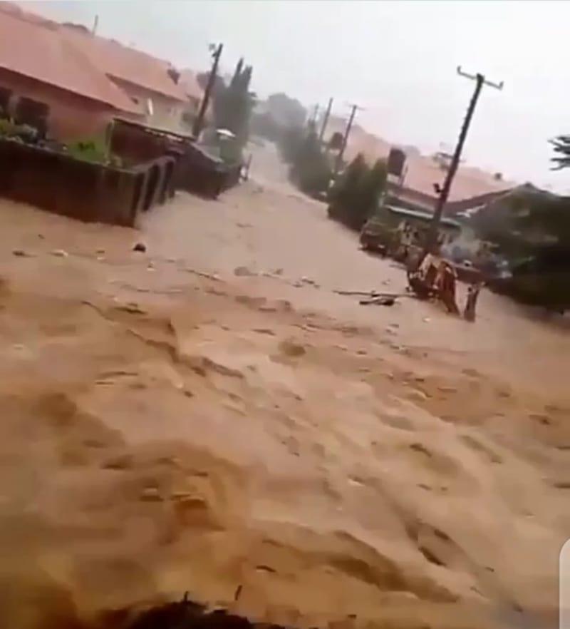 Man Screams For Help As Flood Sweeps Him Away In Abuja (Disturbing Video)