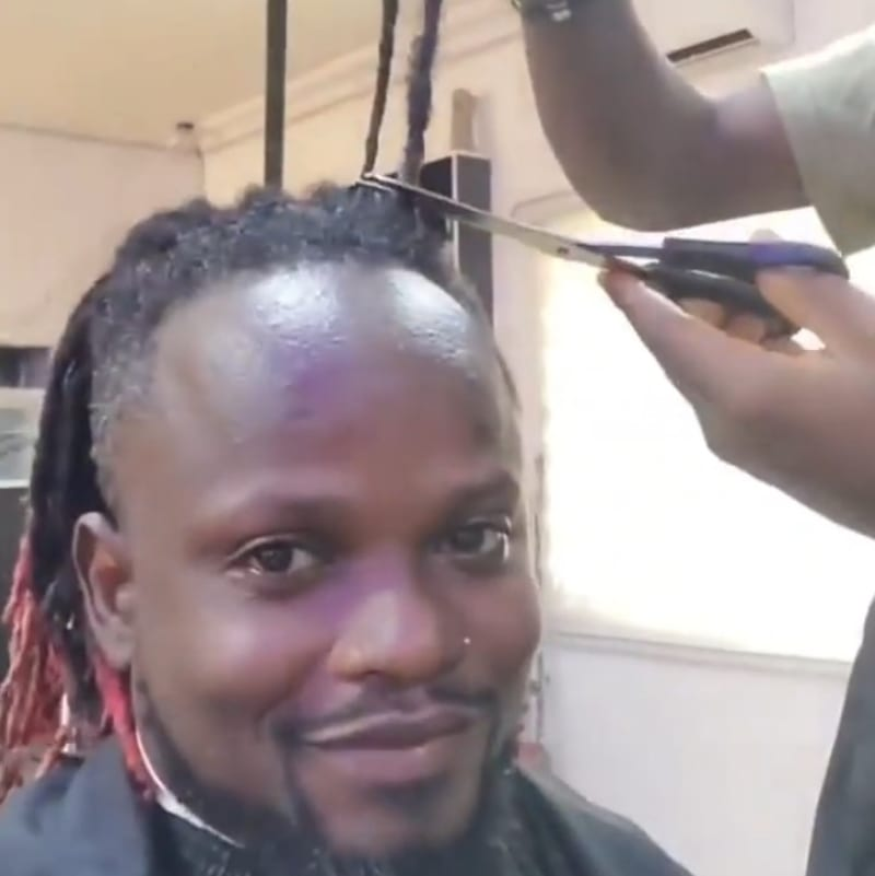 Laycon's Fan Cuts Off His Dreadlocks Of 10 Years To Celebrate Laycon's Victory