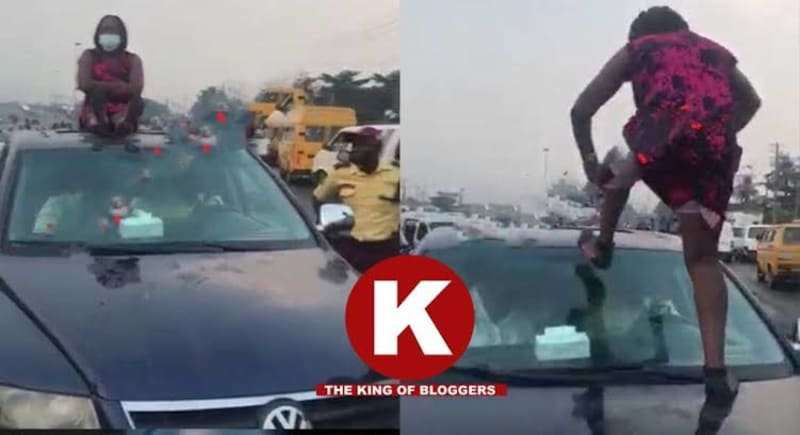 Woman Climbs On Roof Of Car To Prevent LASTMA Officials From Driving It Off