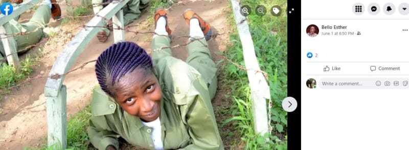 NYSC: Female Corper Poses With A Gun