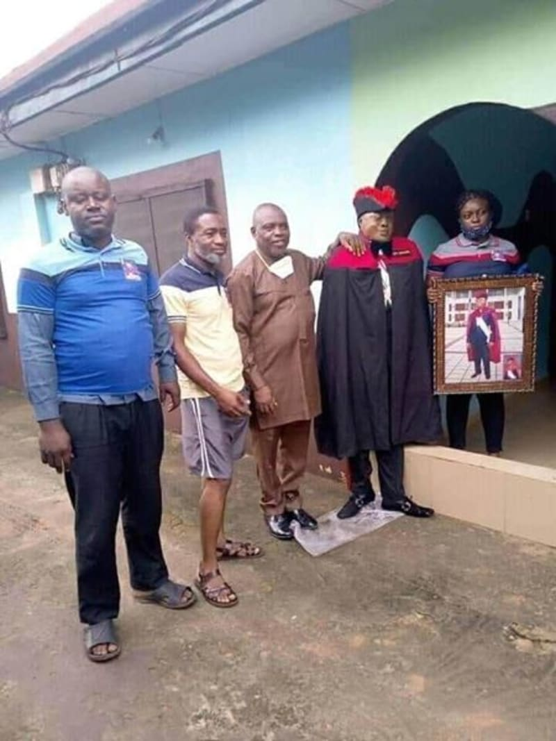 Family Members Take Pictures With A Standing Dead Man (Disturbing Photos)