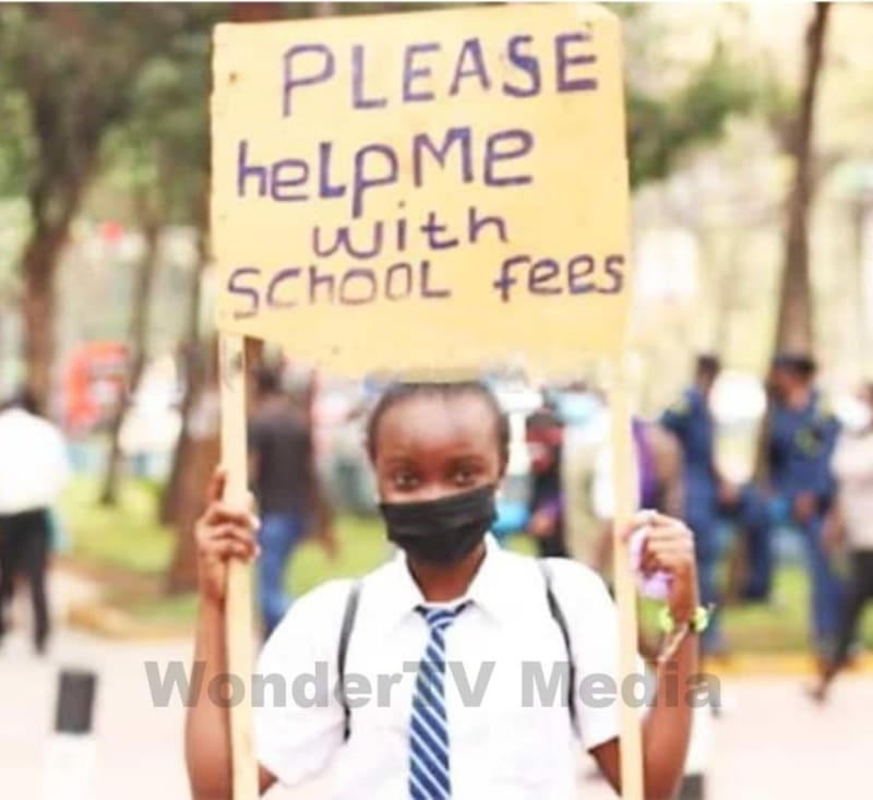 Kenyan Girl Hits The Streets In Uniform With Placard To Beg For Her School Fees
