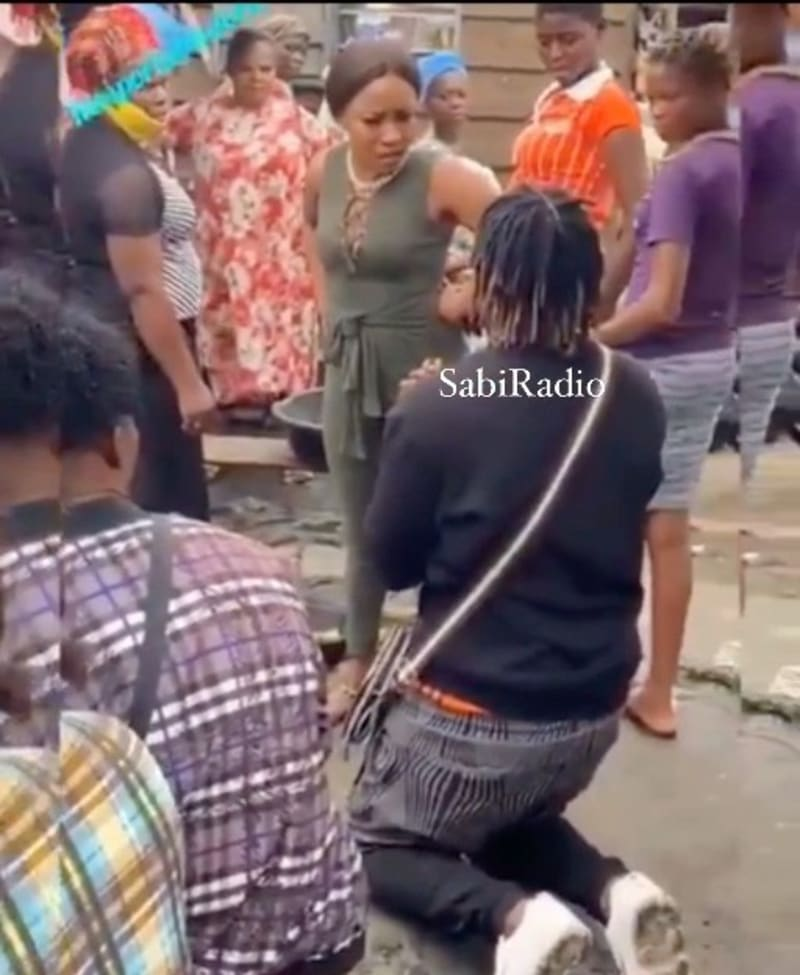 Lady Embarrassed As Boyfriend Kneels Down To Propose To Her At The Market