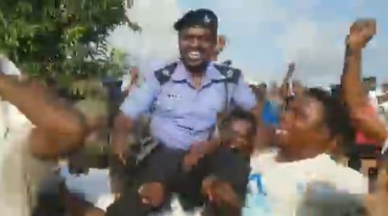 Protesters Carry And Celebrate A Policeman  At End SARS Protest