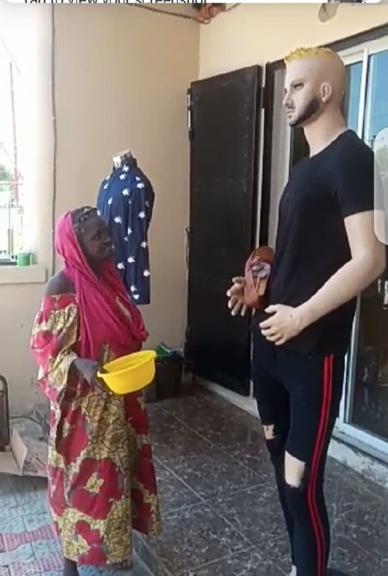 Old Woman Begs Mannequin For Money (Video)