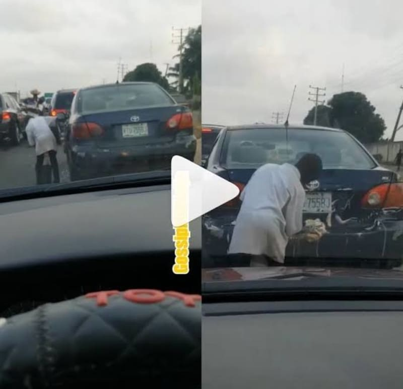 Full Body Of A Moving Car Being Washed In Lagos Traffic (Video)