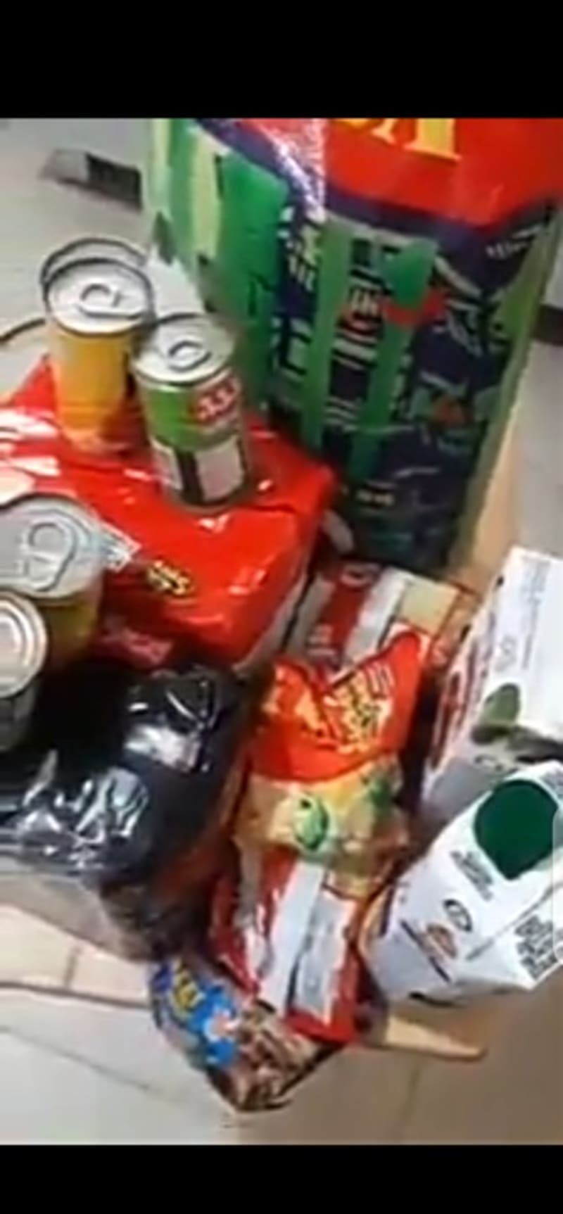 Nigerian In Philippines Displays Relief Items Brought To His House By Government