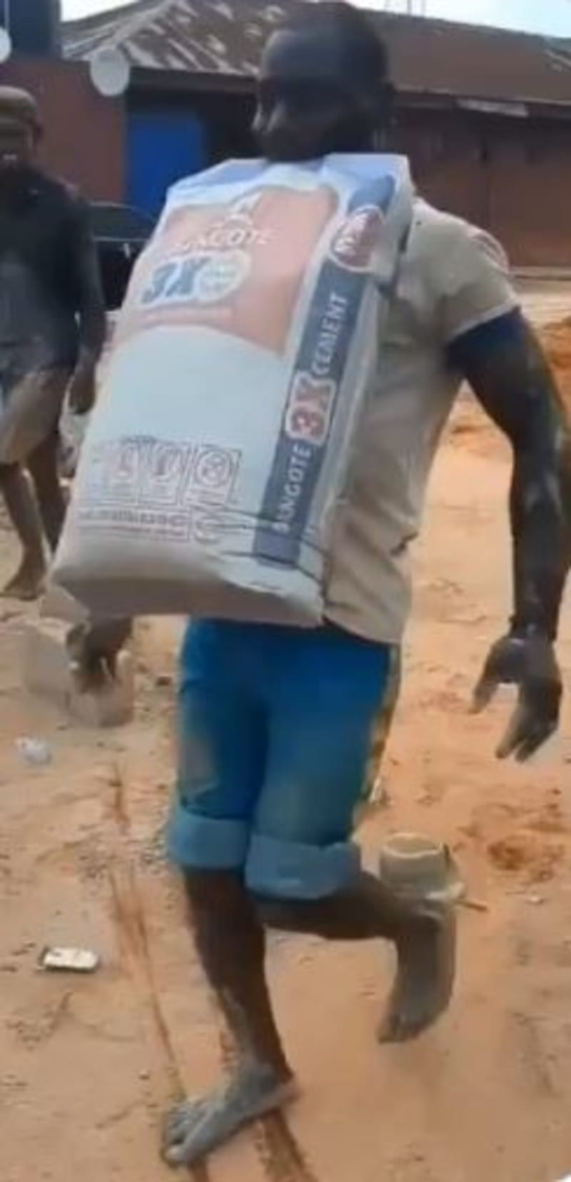 Man Carries 50kg Bag Of Cement With Teeth, Wins 100,000 Naira Bet (Video)