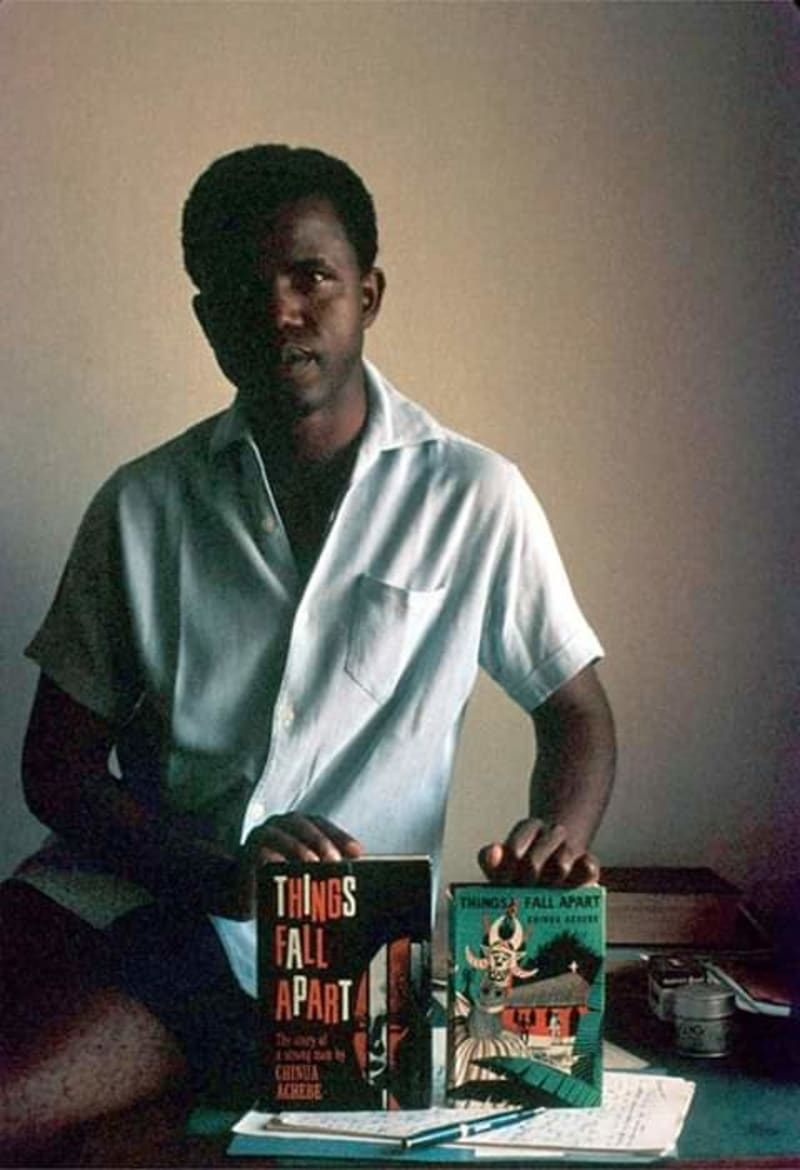 "chinua achebe showing off his book ""things fall apart"" in 1960"