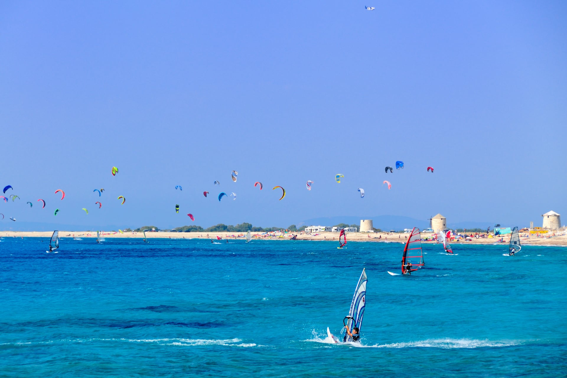 Kite-surfers and wind-surfers in action, Agios Ioannis Lefkada