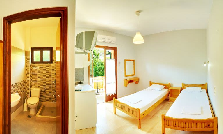 two beds and a bathroom, in one of our rooms