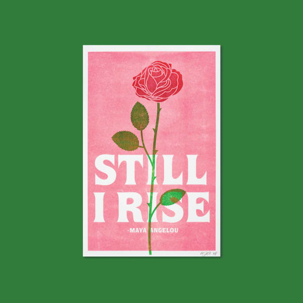 "A coral colored background with the words ""Still I Rise"" in white. A green and red rose with thorns sits over the top."