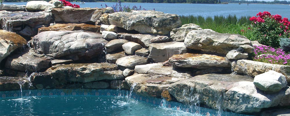 Boulders in a poolside waterfall