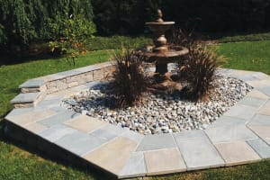 Fountain Surrounded by Decorative Stone and Bluestone