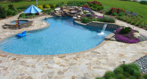Flagstone Pool Decking with Boulder Waterfall