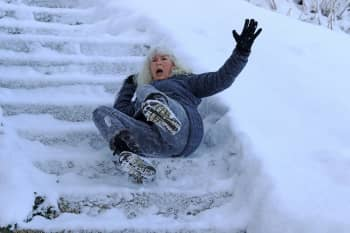 person slip on icy stairs