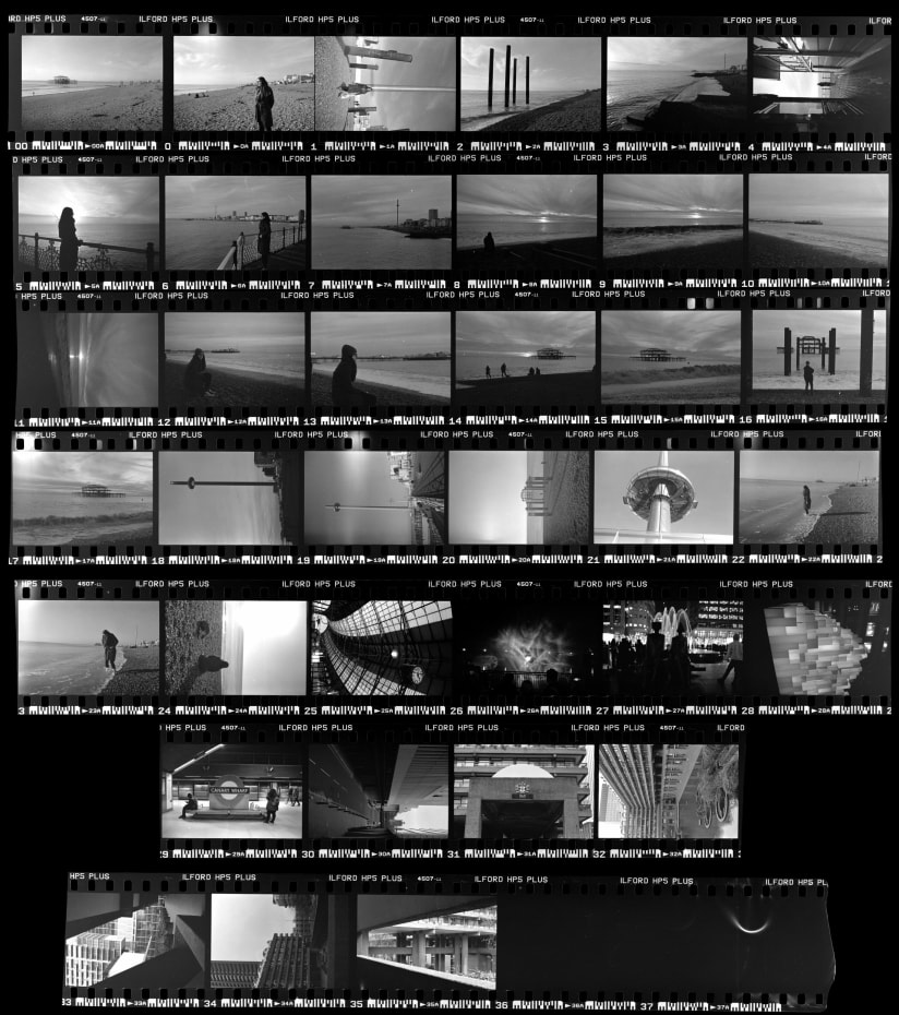 Contact sheet of a black and white film of a trip to Brighton, Canary Wharf and Barbican