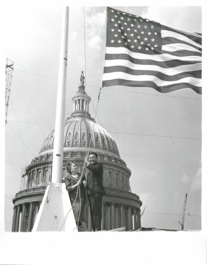 Photo 1143 Senator with Flag on US Capitol: Then Congressman Daniel K. Inouye (Hawaii's first elected U.S. Representative) with American flag with 50 stars in Washington D.C., U.S. Capitol.