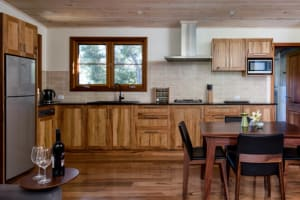 Mira Kitchen with solid wood cabinets and furniture.