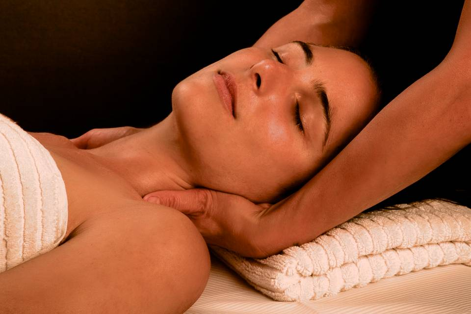 Woman enjoying a Swedish massage.
