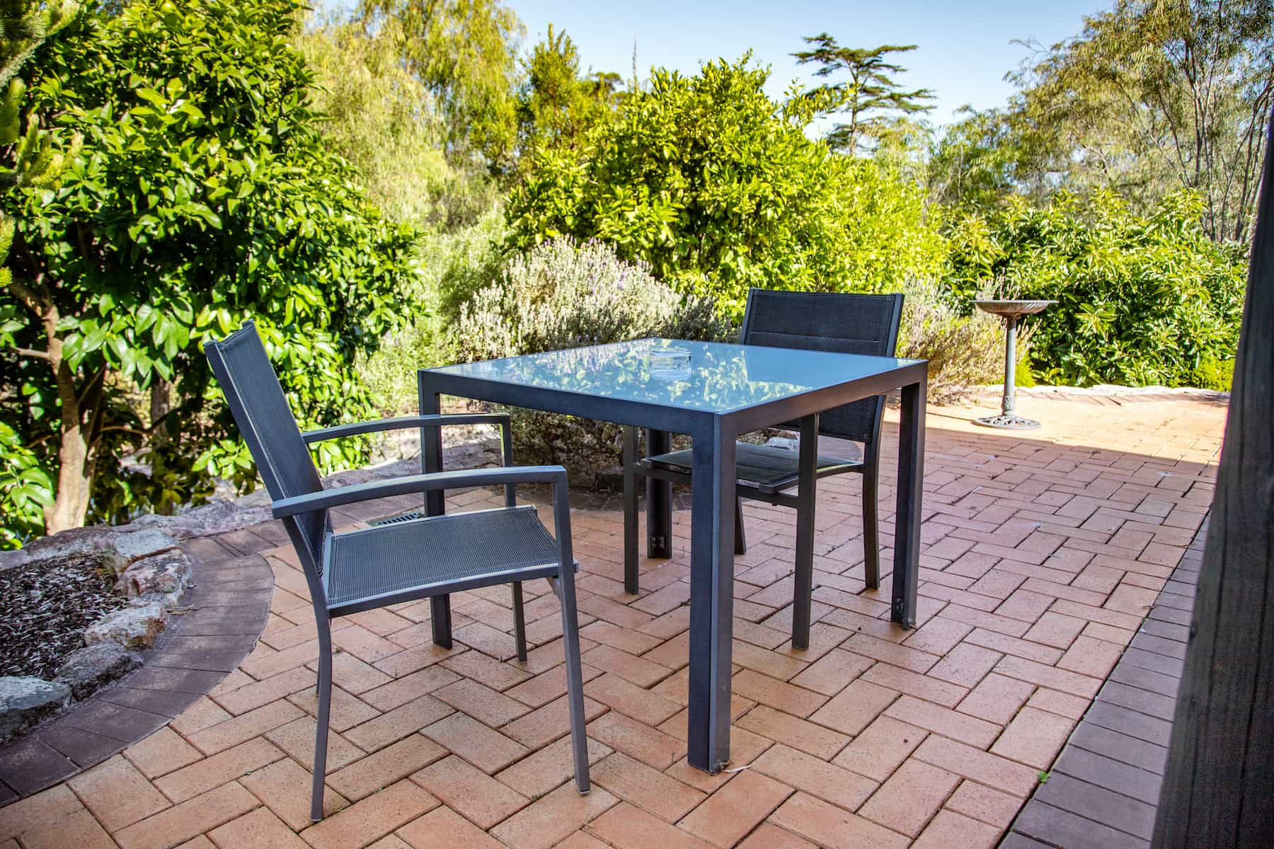 Gampi's outdoor seating area with bird bath