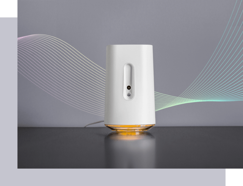 AIRIA is a matte white device about the size of an upside-down pint bottle with an ambient light at the base.