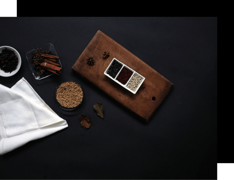 A collection of authentic raw material, including spices, herbs, and woods.