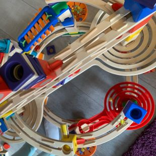 A close up of the marble run which has metalic pieces that play music and a lot of spirales