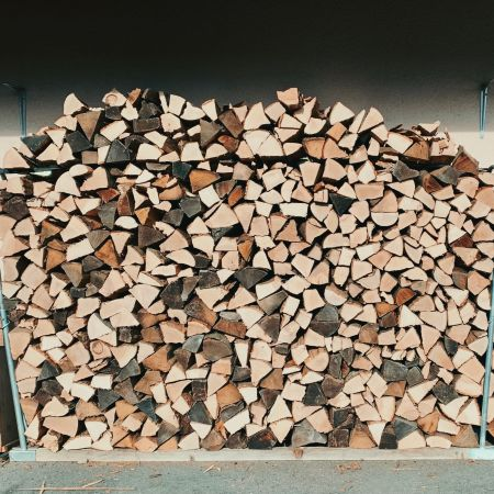 Chimney wood stacking. The stack is about 4 meters long and 2 meters high