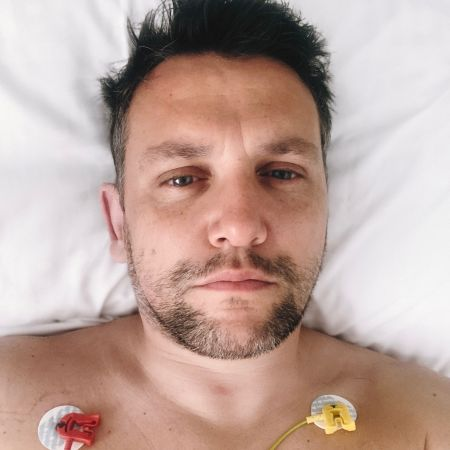 A portrait of me in my bed. I have patches on my chest that record my heartbeat