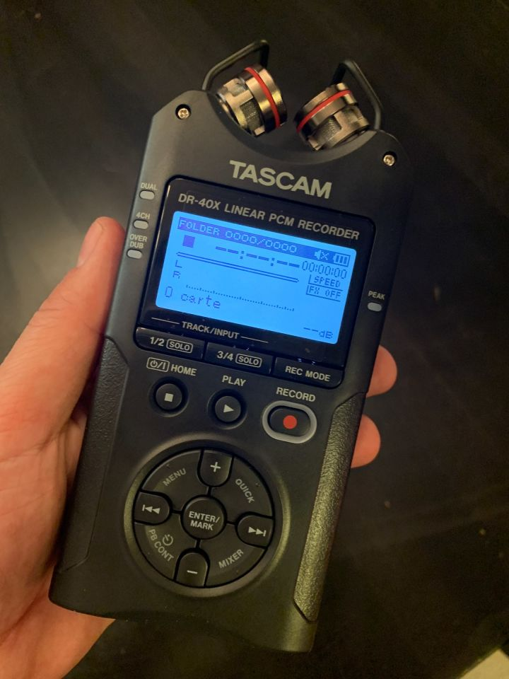 The Tascam DR-40x digital recorder in my hand