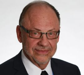 Larry Komer, MD Speaker Bio