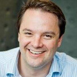 Dr. Simon Kos Headshot