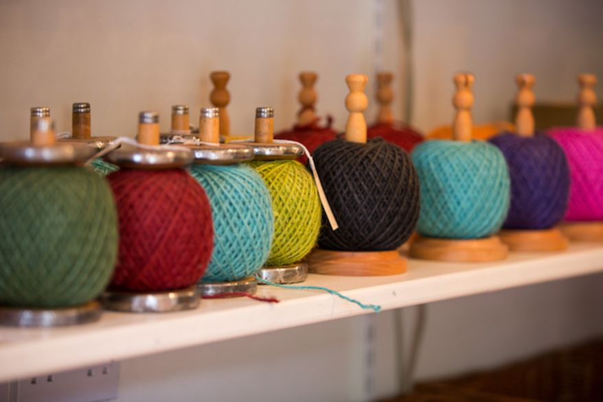 Row of brightly coloured balls of jute