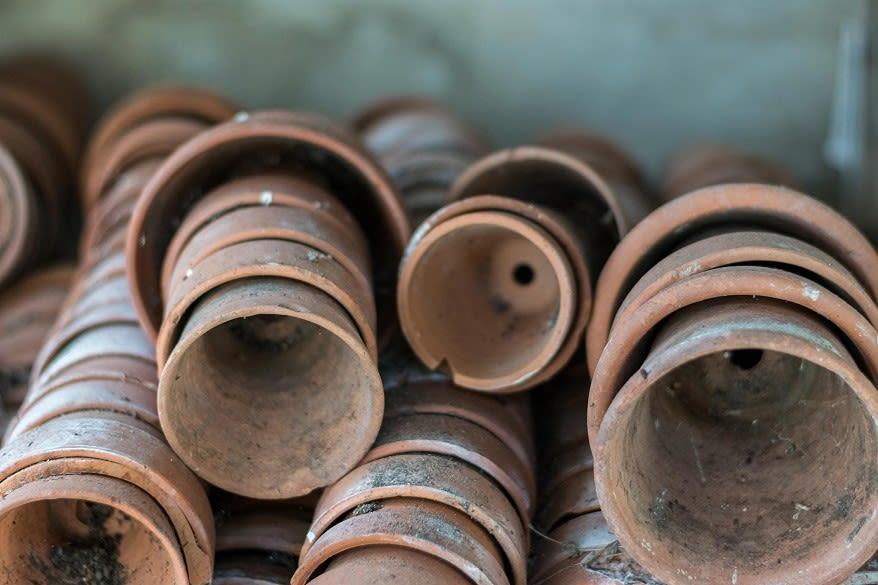 Stacked antique terracotta pots. Photo by Claudio Fonte on Unsplash