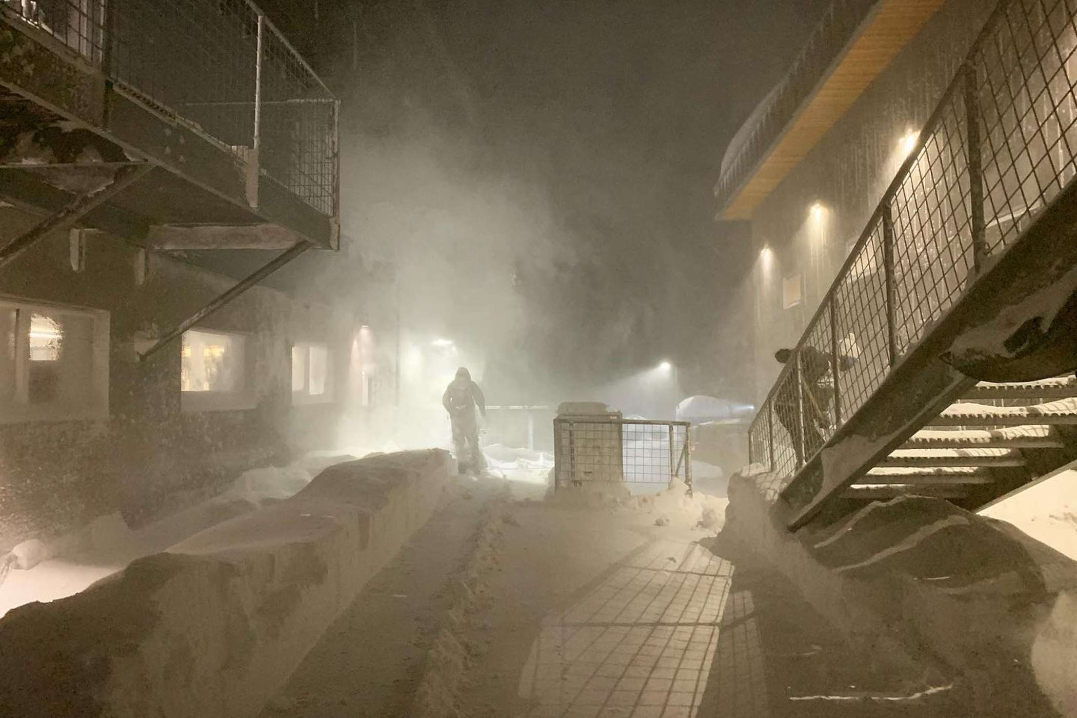 Alta employees clear snow from the Buckhorn building
