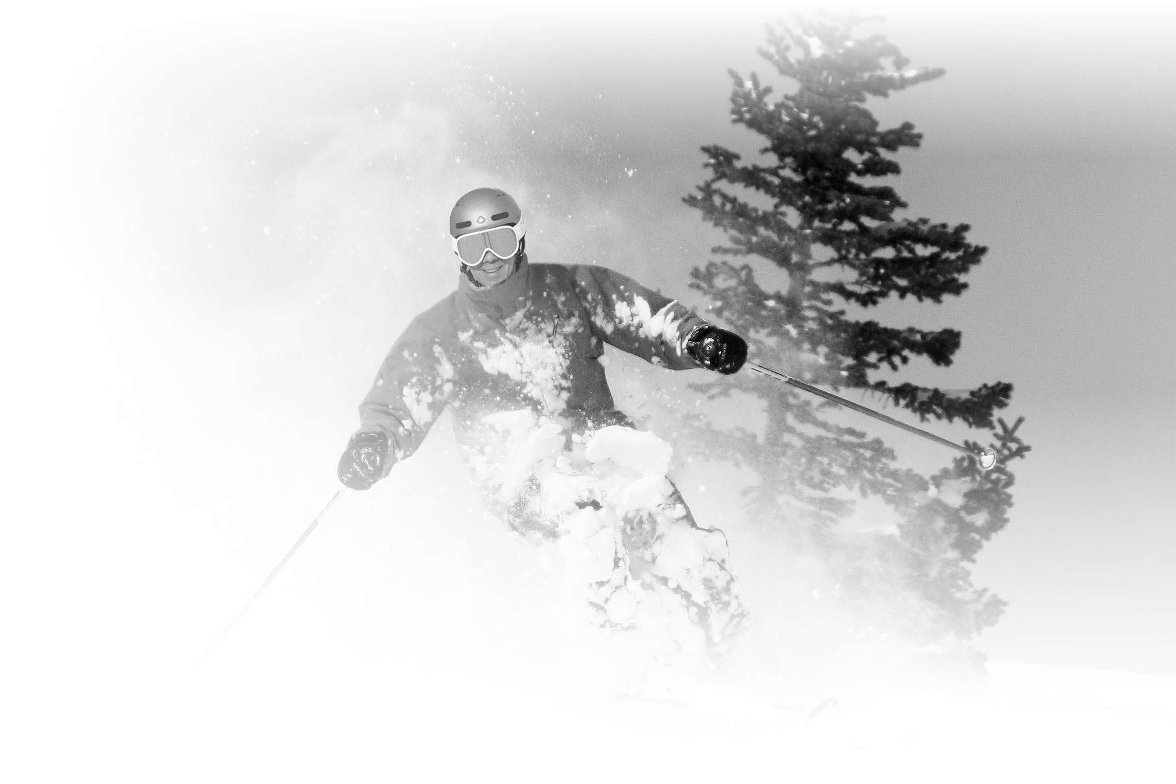 A ski instructor from the Alf Engen ski school enjoys some powder turns at Alta Ski Area