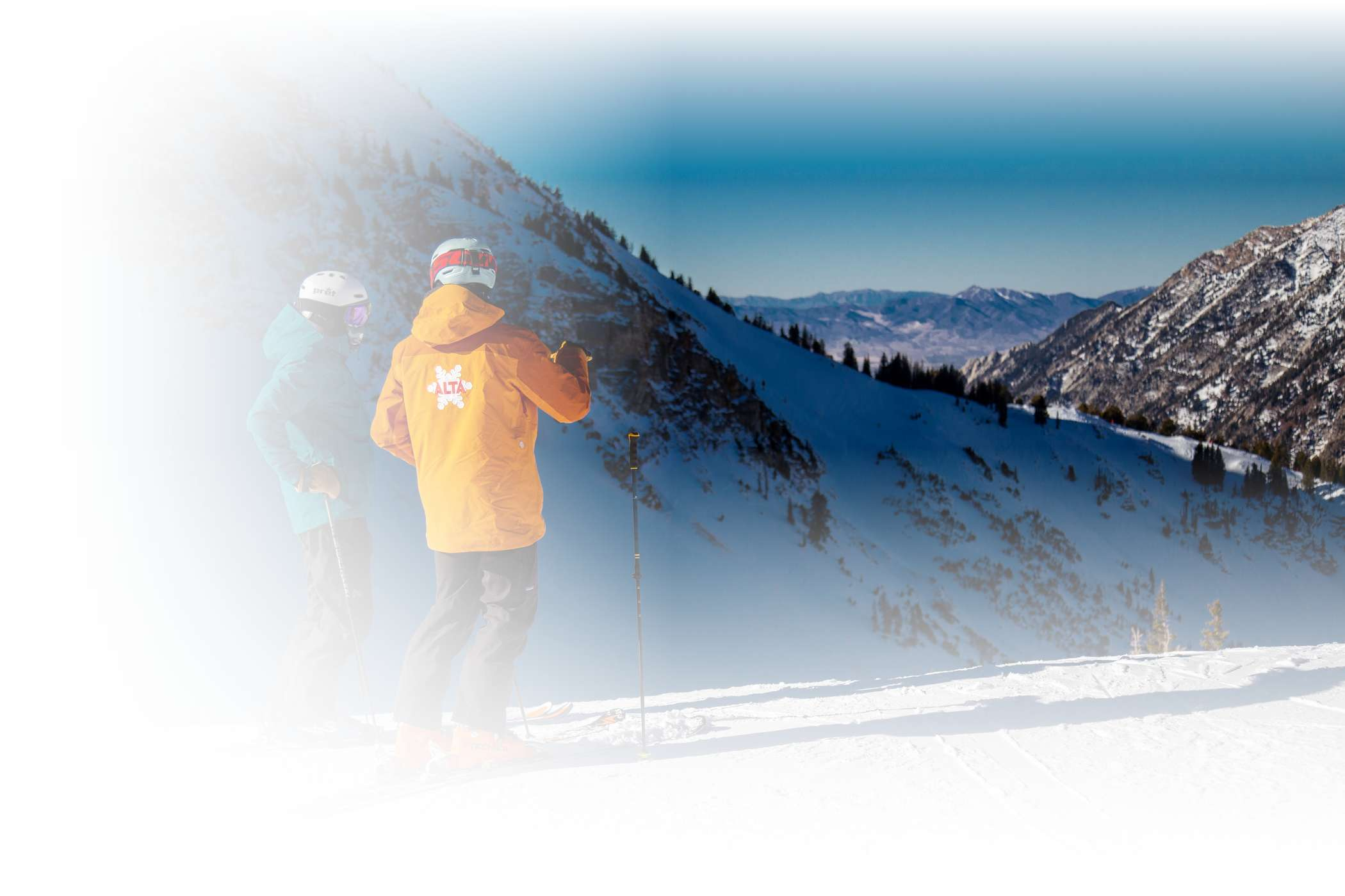 An Alf Engen Ski School instructor guides two skiers around Alta Ski Area on a sunny winter day