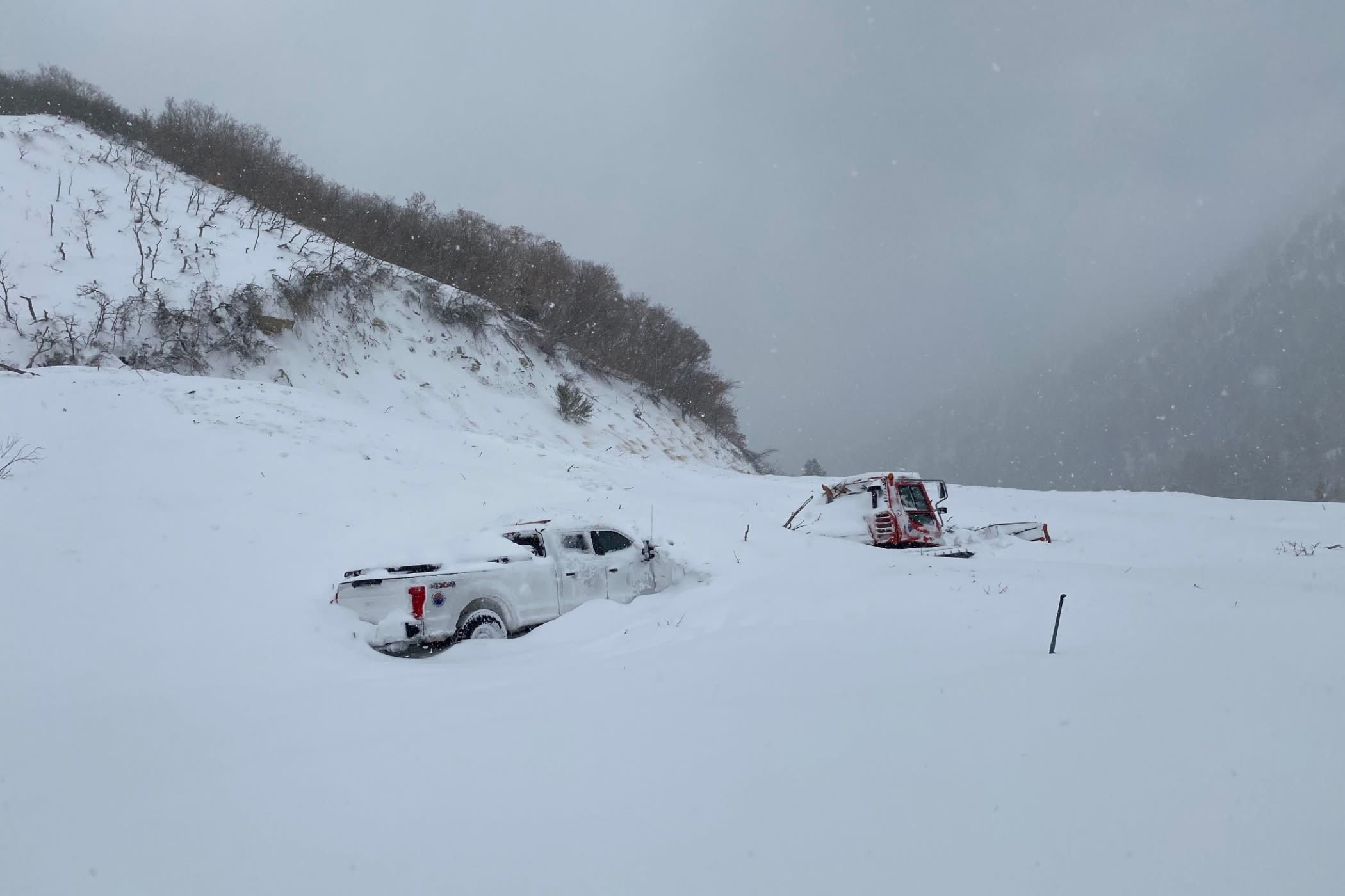 A UDOT truck caught in a natural avalanche