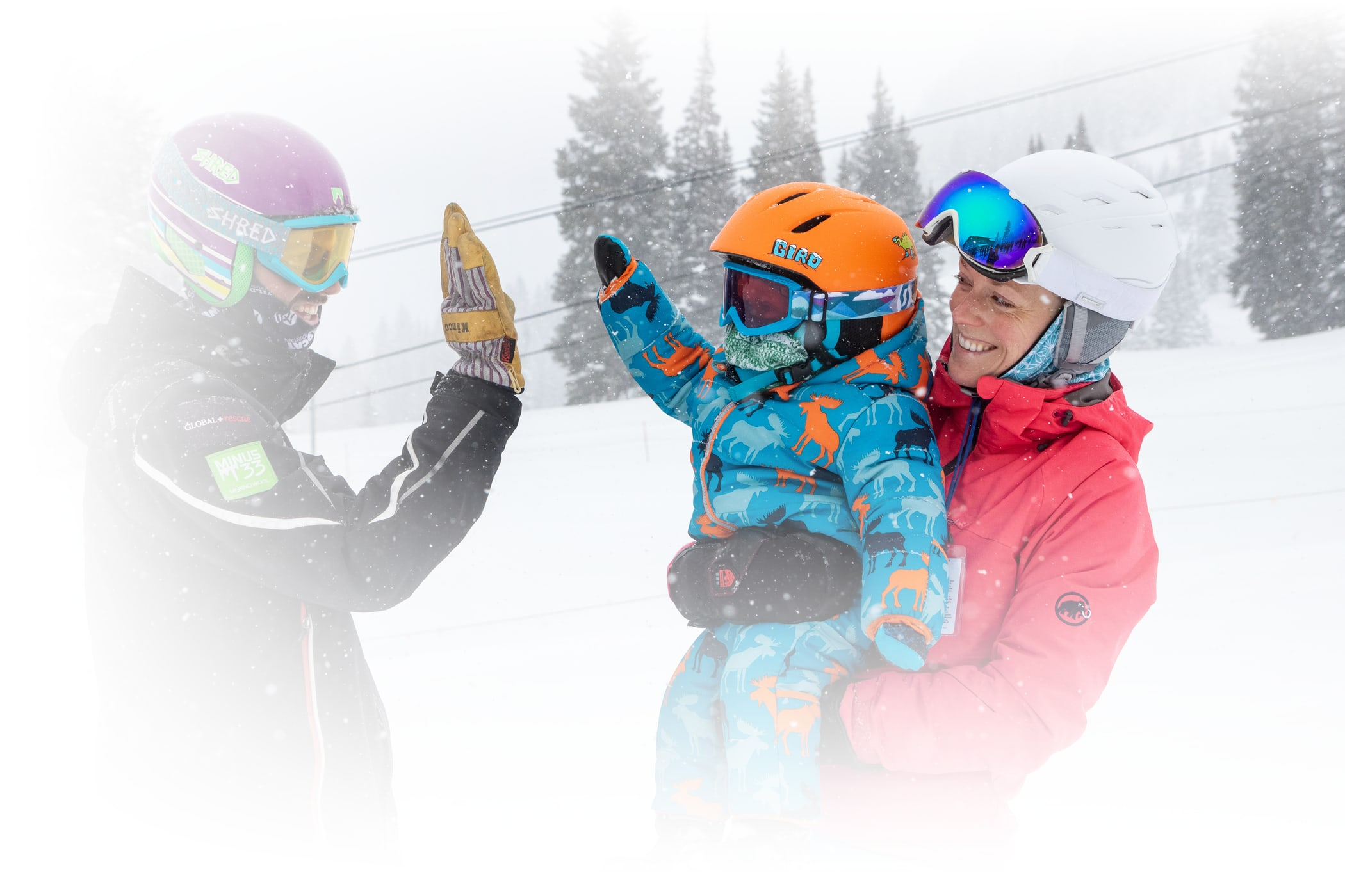 Season Pass Benefits Marquee Image of High-fives in the snow