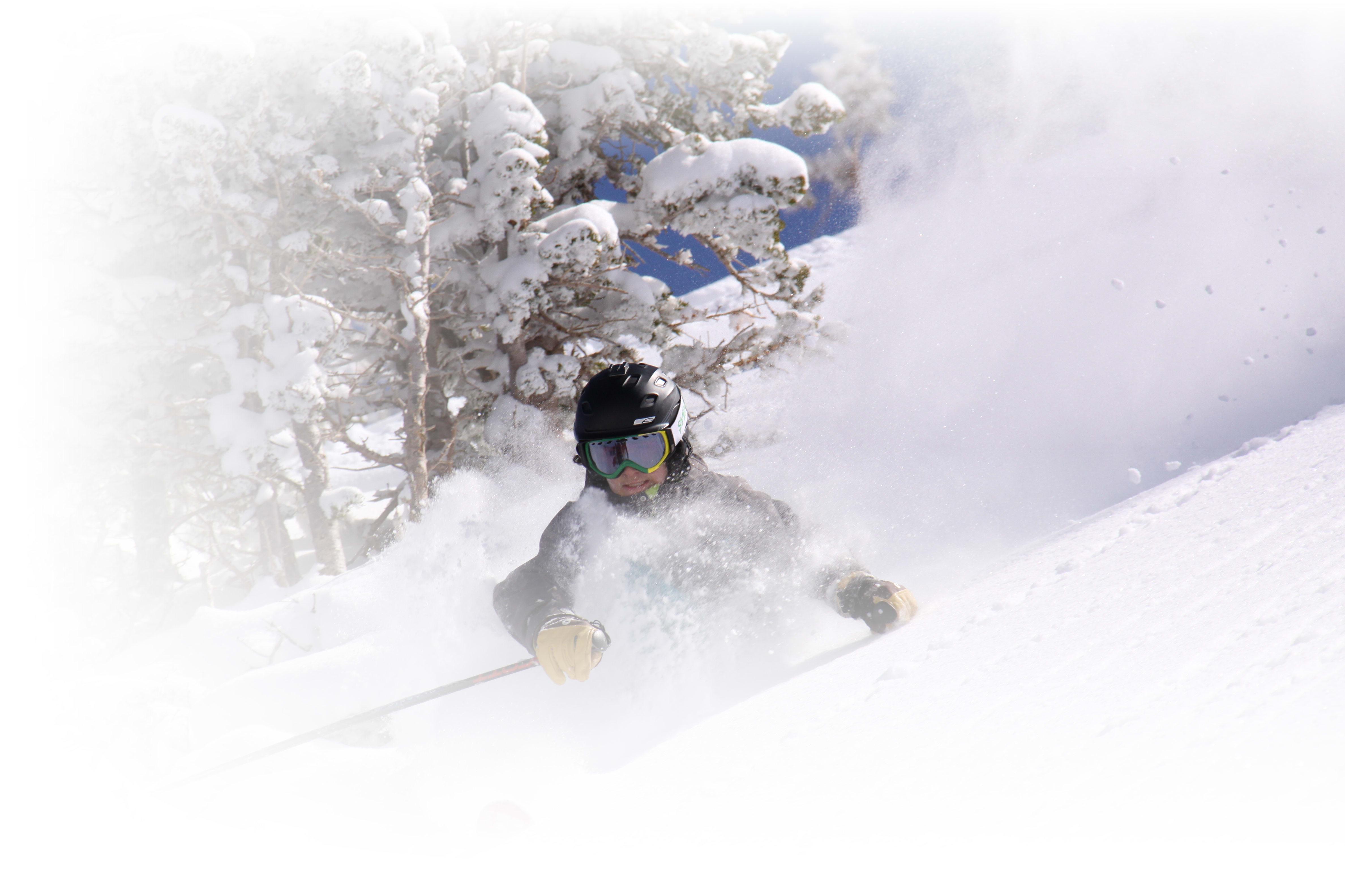 teen skiing in deep powder