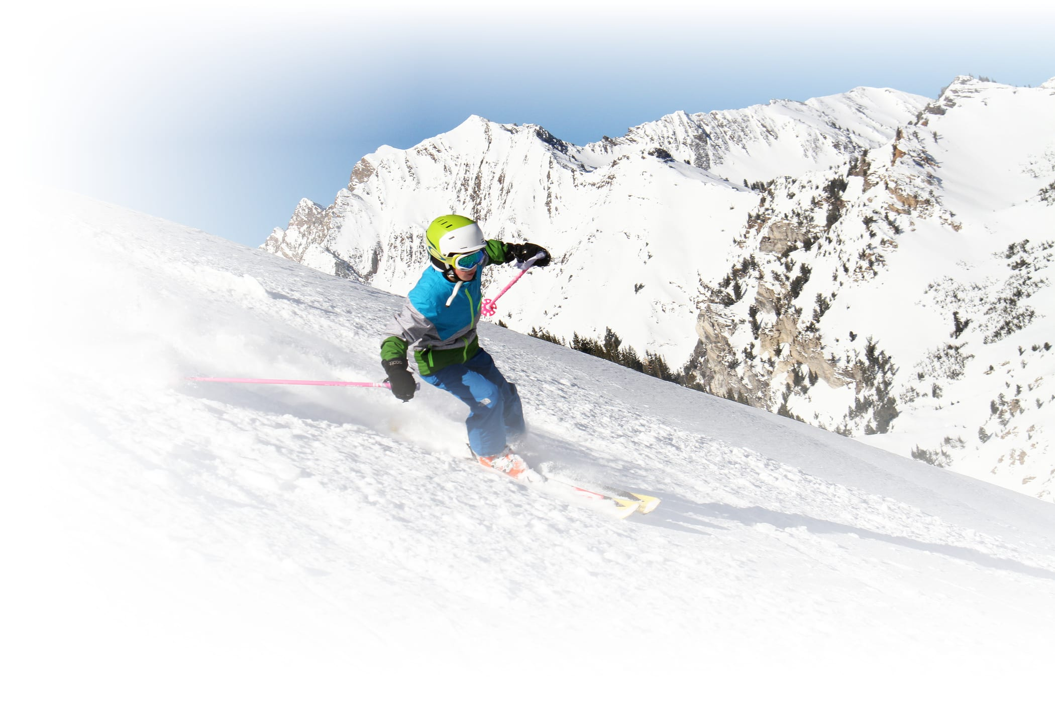 teenager skiing down a tight chute