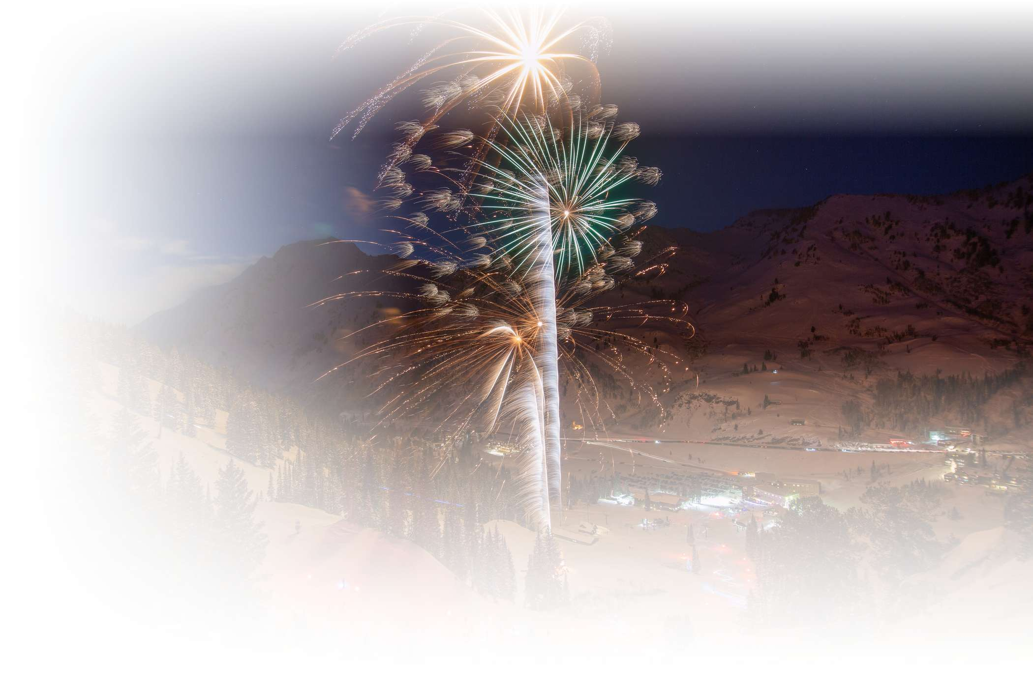 Colorful fireworks over new year's eve torchlight parade at Alta