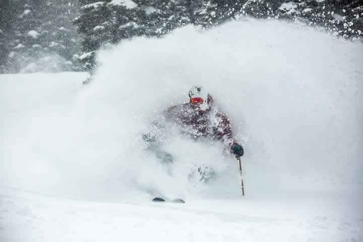 Adam Fehr comes up for air skiing deep powder